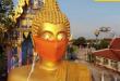 تمثال بوذا في تايلاند يرتدي الكمامة